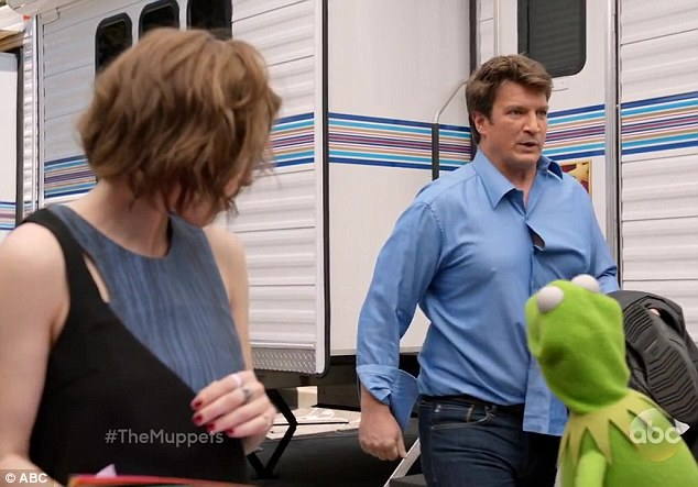 Scandalous: Kermit is shocked to see Castle star Nathan Fillion sneaking out of Miss Piggy's trailer in behind-the-scenes clips from an ABC promo for The Muppets
