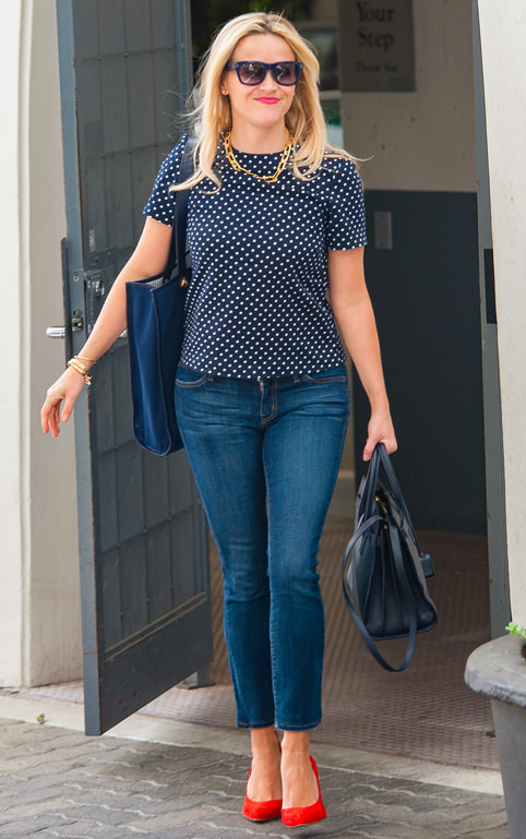 Reese Witherspoon kept the summer vibe going with bold accents and sunnies