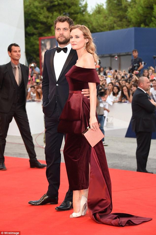 Oh the glamour: She finished off the look with an elegant box clutch
