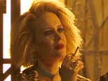 "West Hollywood, CA - Sarah Paulson looking mysterious as she lights up and smokes while talking to her co-star during a night shoot for scenes of the new ""American Horror Story"".  AKM-GSI         September 2, 2015 To License These Photos, Please Contact : Steve Ginsburg (310) 505-8447 (323) 423-9397 steve@akmgsi.com sales@akmgsi.com or Maria Buda (917) 242-1505 mbuda@akmgsi.com ginsburgspalyinc@gmail.com"