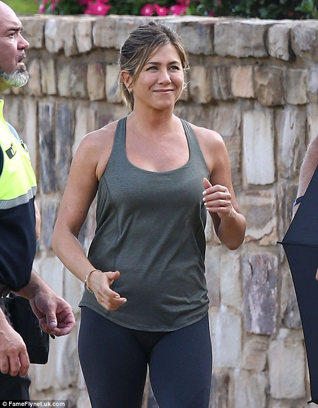 Hard at work: The newlywed star - who tied the knot with Justin Theroux on August 5 in an intimate wedding at their Bel-Air, CA home - was seen filming more scenes in workout gear on Tuesday
