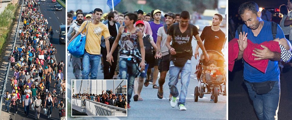 Thousands of refugees abandon Budapest station and start WALKING to Austria