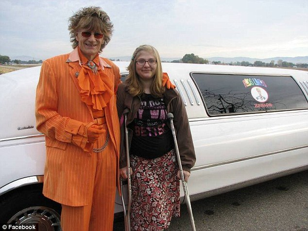 For charity: Randy with a Make-A-Wish recipient named Abigail