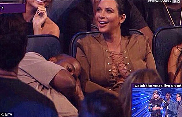 Joker: The musician showed his lighter side as he was spotted by fans pretending to nap on Kim's arm during Taylor's speech