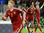 Belgium's Kevin De Bruyne (R) celebrates with Belgium's Vincent Kompany (R) and Belgium's Marouane Fellaini (C) after scoring a goal during the Euro 2016 qualifying match between Belgium and Bosnia and Herzegovina at the King Baudouin Stadium in Brussels, on September 3, 2015. AFP PHOTO / BELGA PHOTO / BRUNO FAHY \n==BELGIUM OUT==BRUNO FAHY/AFP/Getty Images