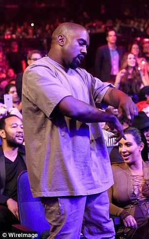 Feeling it: Kanye was also spotted busting out some moves before accepting his accolade
