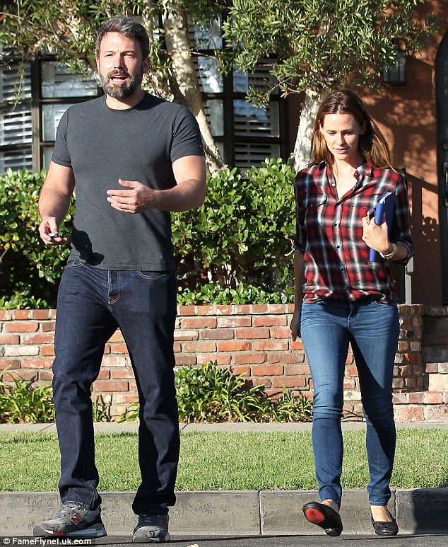 Silver fox: The bearded Gone Girl actor dressed his 6ft4in leading man frame in a charcoal T-shirt, dark denim jeans, and grey New Balance trainers