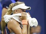 Sep 3, 2015; New York, NY, USA; Caroline Wozniacki of Denmark sits in her chair against Petra Cetkovska of the Czech Republic (not pictured) on day four of the 2015 U.S. Open tennis tournament at USTA Billie Jean King National Tennis Center. Mandatory Credit: Geoff Burke-USA TODAY Sports  / Reuters  Picture Supplied by Action Images *** Local Caption *** 2015-09-04T043732Z_407844506_NOCID_RTRMADP_3_TENNIS-U-S-OPEN.JPG