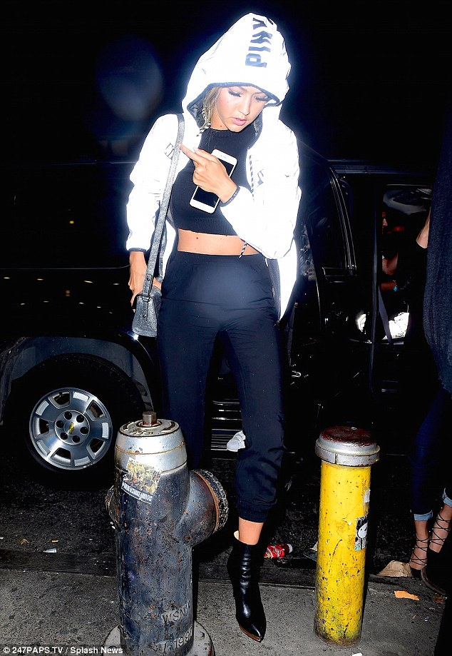 Ready to party: Gigi, 20, headed to the second venue of the night in a pair of heeled leather boots