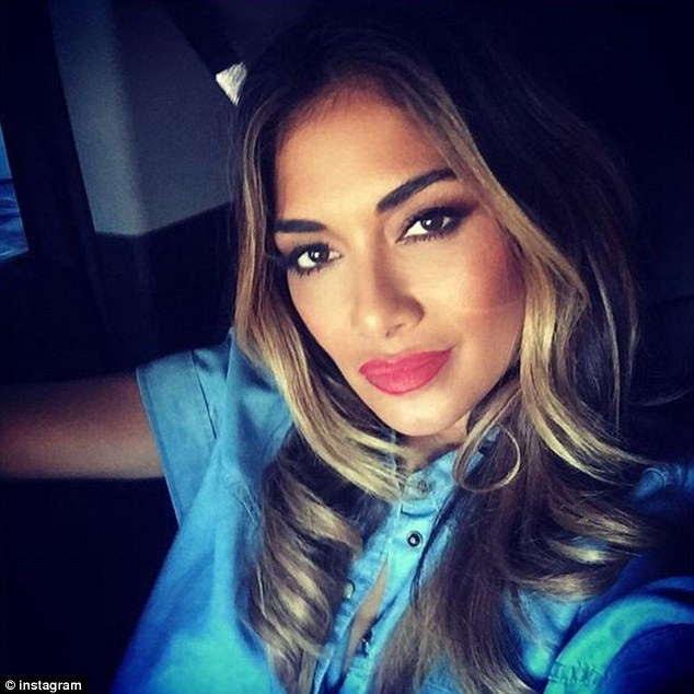 Onwards and upwards: The Pussycat Dolls beauty revealed she was on her way to the airport on Sunday