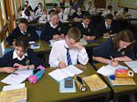 Secondary school students studying in classroom, UK. A90531