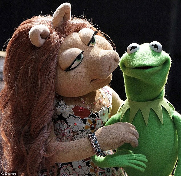 That was quick: Kermit moved on very quickly from his split with Miss Piggy and is now dating a brunette named Denise (pictured)