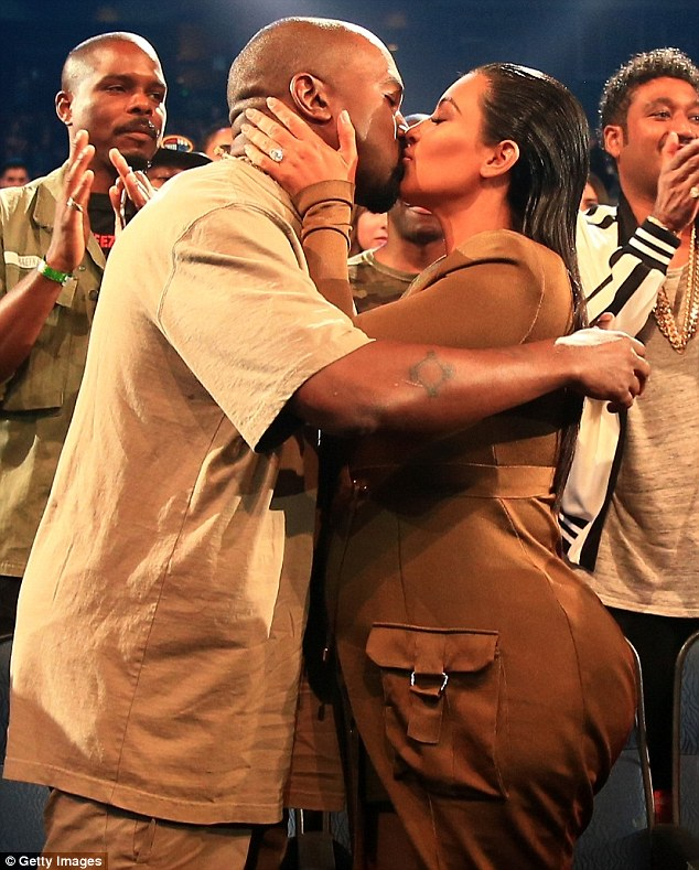 Sealed with a loving kiss: Kanye made the news official by planting a kiss on his wife Kim after the speech