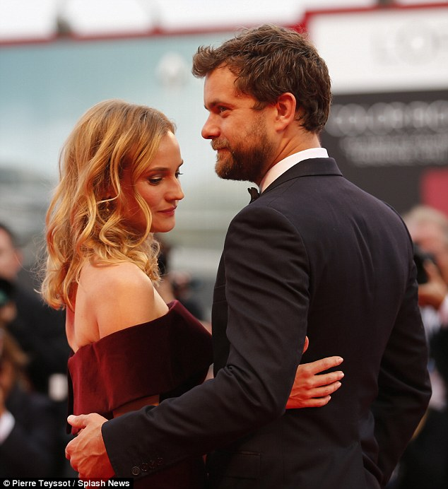 Cute twosome: Diane and Joshua hugged each other tenderly as they span around to the cameras