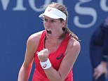 Konta pumps her fist on her way to victory over the US Open's No 9 seed Spaniard Muguruza on Thursday
