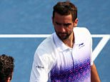 NEW YORK, NY - SEPTEMBER 04:  Marin Cilic of Croatia shakes hands with Mikhail Kukushkin of Kazakhstan after defeating him in their Men's Singles Third Round match on Day Five of the 2015 US Open at the USTA Billie Jean King National Tennis Center on September 4, 2015 in the Flushing neighborhood of the Queens borough of New York City.  (Photo by Clive Brunskill/Getty Images)