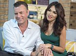 EDITORIAL USE ONLY. NO MERCHANDISING  Mandatory Credit: Photo by Ken McKay/ITV/REX Shutterstock (4862714bb)  TELEVISION PROGRAMME: 'This Morning' TV Programme, London, Britain. - 23 Jun 2015  Duncan Bannatyne and Nigora Whitehorn  DUNCAN BANNATYNE - EXCLUSIVE:  Last weekend, Ex-Dragon's Den star Duncan Bannatyne found himself at the centre of a very public spat with his ex-girlfriend after she accused him of threatening her with revenge porn. Duncan furiously denied the claims taking to Twitter to vent his fury. He joins us today, for an exclusive interview with his new girlfriend Nigora, to set the record straight.