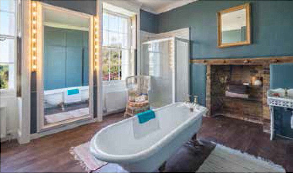 Lap of luxury: A bathroom in the eight-bedroom house in the heart of luvvie-land shows how it mixes periodic features with some modern ones