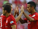 Bayern's goalkeeper Manuel Neuer, right, and Douglas Costa warm up prior to the German Bundesliga soccer match between FC Bayern Munich and Bayer Leverkusen 04 in Munich, Germany, Saturday, Aug. 29, 2015. (AP Photo/Matthias Schrader)