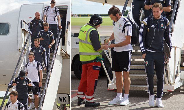 Gareth Bale touches down in Cardiff after heading Wales to the brink of Euro 2016