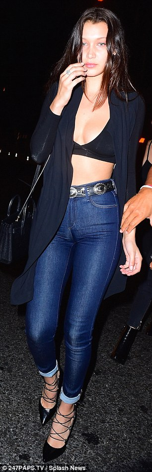 Simple but stylish: The latest addition to the Victoria's Secret PINK roster added a casual touch with a pair of blue skinny jeans and a black longline cardigan