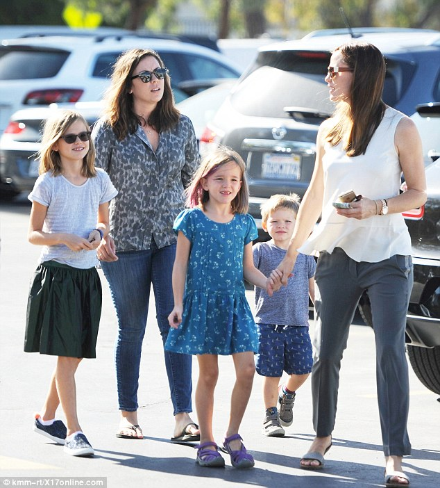 New nanny! The two-time Golden Globe winner looked after their three children - Violet, 9, Seraphina, 6, and Samuel, 3 - while Garner filmed Miracles from Heaven in Atlanta (pictured last Sunday)