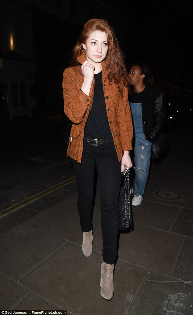 Effortless: Nicola Roberts kept her look simple in a burnt orange jacket which she teamed with a black T-shirt and black skinny jeans