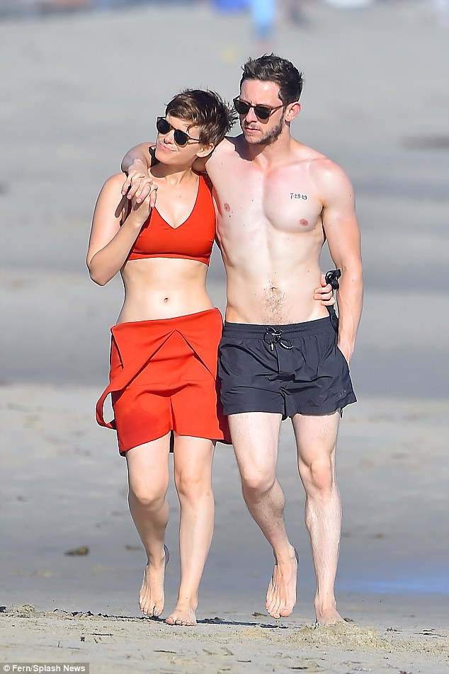 Cuddling up:The show of togetherness follows weeks of speculation that the pair's long-term friendship has blossomed into romance