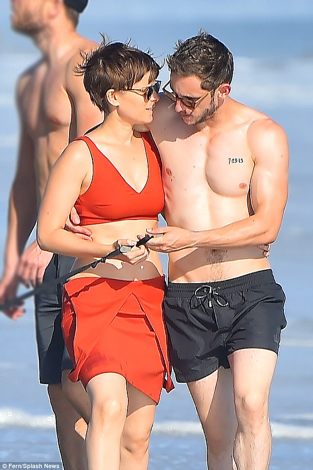 Isn't love Fantastic! Jamie Bell and bikini-clad Kate Mara make no attempt to hide their romance as they walk her dog on the beach on Monday
