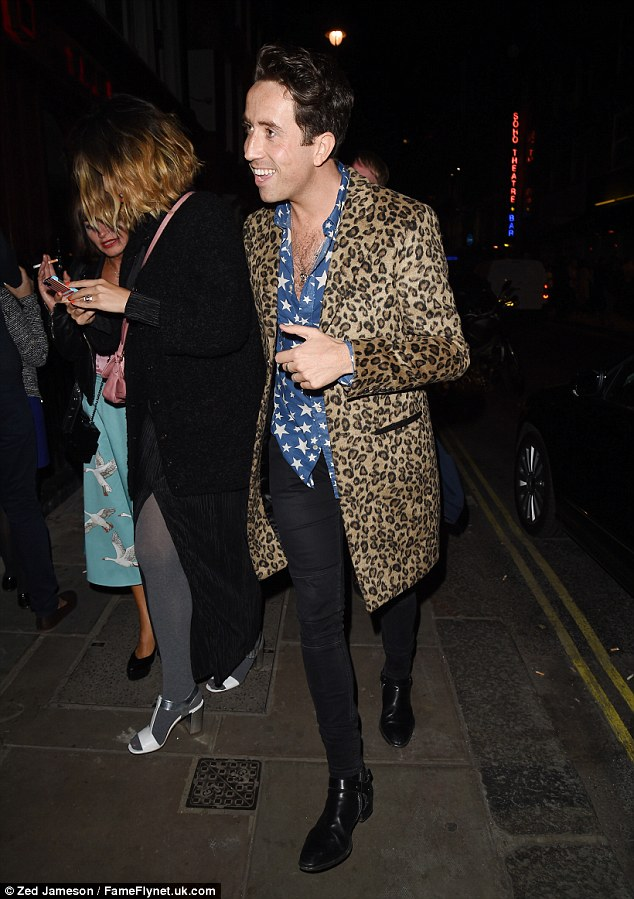 Stars and spots: Nick donned a shirt emblazoned with stars with a leopard print jacket for his night on the town