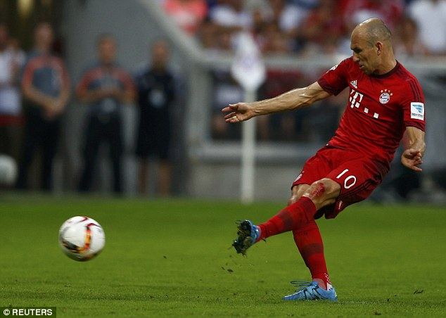 Arjen Robben slots home the penalty to give the Bundesliga champions a three-goal lead