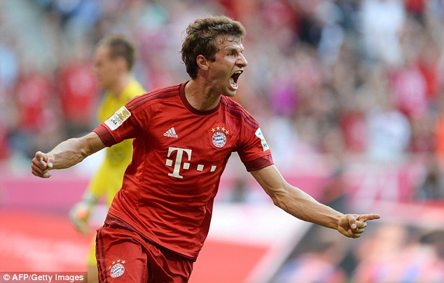 Thomas Muller celebrates after putting Bayern Munich ahead against Bayer Leverkusen