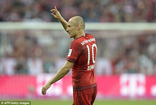 The Dutchman signals to the crowd after his strike as Bayern moved back to the top of the league
