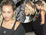 Miley Cyrus and Australian singer Cody Simpson were seen leaving through a discreet back exit at 'The Nice Guy' bar in West Hollywood, CA. Miley was still wearing her Blonde mattered Dread lock hair extensions from the VMA Awards show. Cody Simpson tried to cover his head with a leather jacket as he was leaving the bar.  Pictured: Miley Cyrus, Cody Simpson Ref: SPL1115859  040915   Picture by: SPW / Twist / Splash News  Splash News and Pictures Los Angeles: 310-821-2666 New York: 212-619-2666 London: 870-934-2666 photodesk@splashnews.com