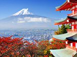 A general view of Mount Fuji in Japan. Mount Fuji, located on Honshu Island, is the highest mountain in Japan at 3,776.24 m. An active stratovolcano that last erupted in 1707?08, Mount Fuji lies about 100 kilometres south-west of Tokyo, and can be seen from there on a clear day       DBCBMD Mt. Fuji with fall colors in japan.