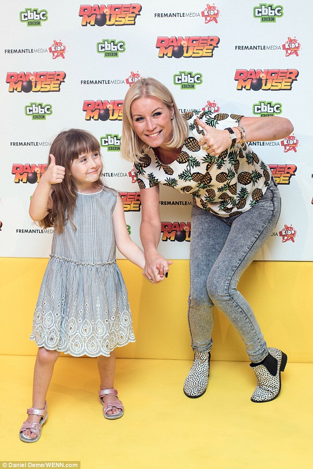 Cute duo: Betsy looked at her mum as they held hands on the yellow carpet