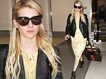 September 04, 2015: Emma Roberts returns from New Orleans and arrives at LAX airport in a yellow dress and leather motorcycle jacket in Los Angeles, CA.\nMandatory Credit: INFphoto.com Ref: inf-00