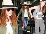 September 04, 2015: Julianne Moore, husband Bart Freundlich and their children Caleb and Liv depart from LAX airport in Los Angeles, CA.\nMandatory Credit: INFphoto.com Ref: inf-00
