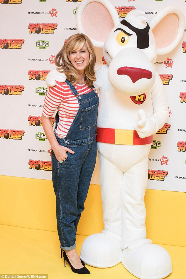 Cheeky: She enjoyed a hug with the star of the show as CBBC relaunched Danger Mouse