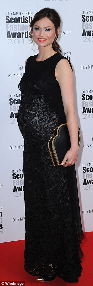 Sophisticated:Sophie's chic red carpet maternity style consisted of a black, lace gown, the sheer material of the frock flaunting her changing shape