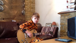 10-Year Old Jammin' The Blues In His Onesie Jammies Will Blow You Away