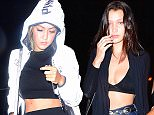 Gigi and Bella Hadid were spotted arriving to the Travis Scott Album Release party in NYC. Gigi wore a reflective anti-paparazzi jacket as she arrived to the club, attempting to go incognito. Her sister instead chose to show a lot of skin.  Pictured: Gigi Hadid , Bella Hadid Ref: SPL1116648  040915   Picture by: 247PAPS.TV / Splash News  Splash News and Pictures Los Angeles: 310-821-2666 New York: 212-619-2666 London: 870-934-2666 photodesk@splashnews.com