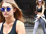 EXCLUSIVE TO INF.\nSeptember 4, 2015: Gigi Hadid strips down to her sports bra as she steps out in workout gear in New York City with friends.\nMandatory Credit: Matthew Nelson/INFphoto.com Ref.: infusny-293