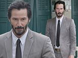 Keanu Reeves walks on the Deauville promenade, on the opening day of the 41st American Film Festival, Friday, Sept. 4 , 2015, in Deauville, Normandy, Western France. (AP Photo/Lionel Cironneau)