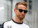 MONZA, ITALY - SEPTEMBER 03:  Jenson Button of Great Britain and McLaren Honda walks with his wife Jessica Button in the paddock during previews to the Formula One Grand Prix of Italy at Autodromo di Monza on September 3, 2015 in Monza, Italy.  (Photo by Charles Coates/Getty Images)