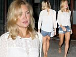 September 04, 2015: Kate Hudson shows off her legs in a pair of denim shorts and wedge heels as she leaves her hotel and heads to dinner in New York City.\nMandatory Credit: T.Jackson/INFphoto.com Ref: infusny-283
