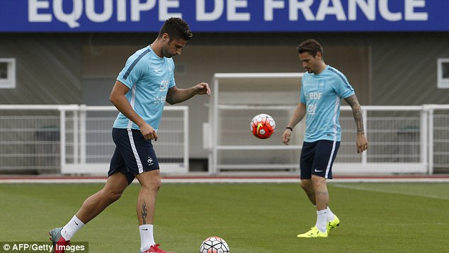 Debuchy (right), seen alongside Olivier Giroud in training, is currently on international duty with France