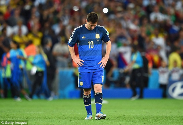 It's all over: Messi looks to the ground after Germany win the World Cup at the Maracana