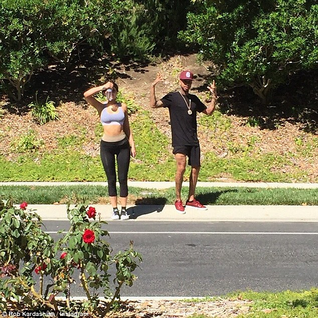 Keeping Up With Rob: The star shared this snap of Kylie and Tyga a few days ago, writing, 'Spotted these fools on the morning workout'
