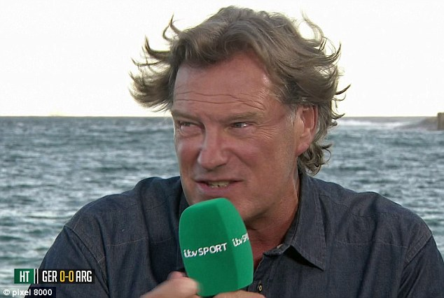 Interesting: Glenn Hoddle's hair was battered by the wind but his analysis was spot on for ITV